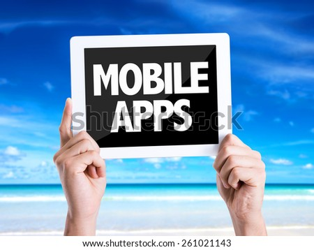 Tablet pc with text Mobile Apps with beach background - stock photo