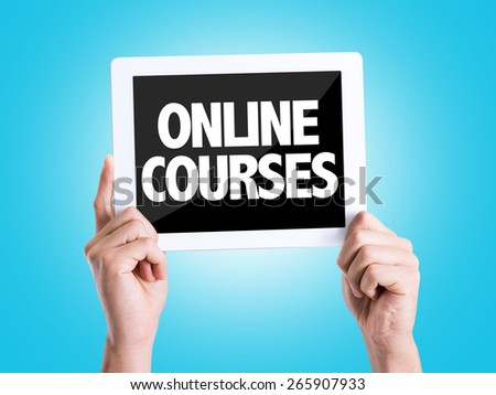 Tablet pc with text Online Courses with blue background - stock photo