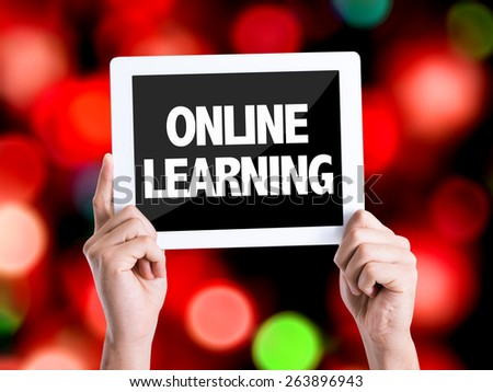 Tablet pc with text Online Learning with bokeh background - stock photo