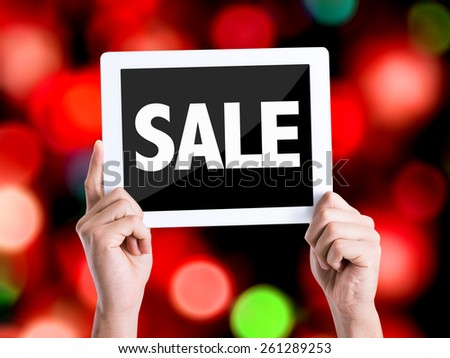 Tablet pc with text Sale with bokeh background - stock photo