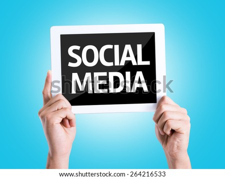 Tablet pc with text Social Media with blue background - stock photo