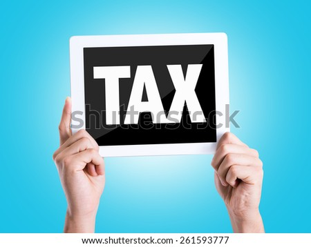 Tablet pc with text Tax with blue background - stock photo