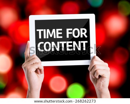 Tablet pc with text Time For Content with bokeh background - stock photo
