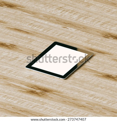 Tablet pc with touch screen on wooden textured background. - stock photo