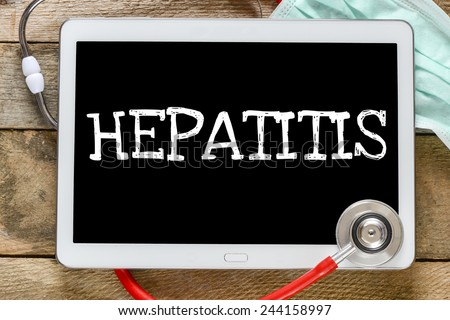 Tablet pc with word Hepatitis. Tablet pc with word Hepatitis and stethoscope, medicine concept - stock photo