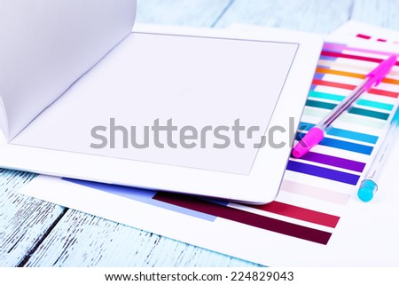 Tablet, pen and paper on wooden background - stock photo
