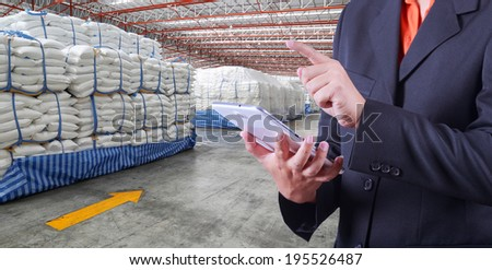 tablet to handle export and import goods stock  in warehouse - stock photo