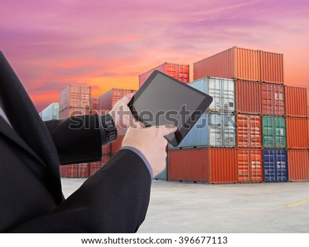 tablet to handle export and import shipping containers at the docks with beautiful sky - stock photo
