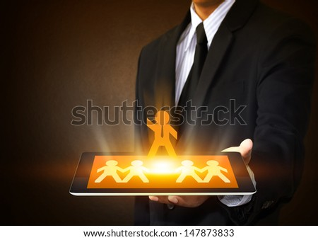 Tablet touch screen with leadership concept - stock photo