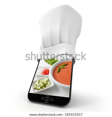 Tablet wearing a chefs toque with the picture of a home made gazapacho - stock photo