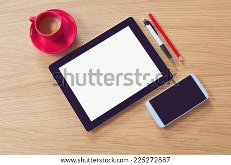 Tablet with blank screen on wooden table. Office desk mock up. View from above - stock photo