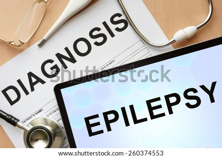 Tablet with diagnosis Epilepsy and stethoscope.  - stock photo