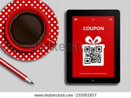 tablet with discount coupon and  cup of coffee lying on white tablecloth - stock photo