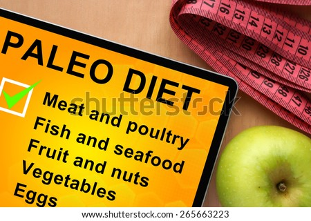Tablet with paleo diet food list   - stock photo