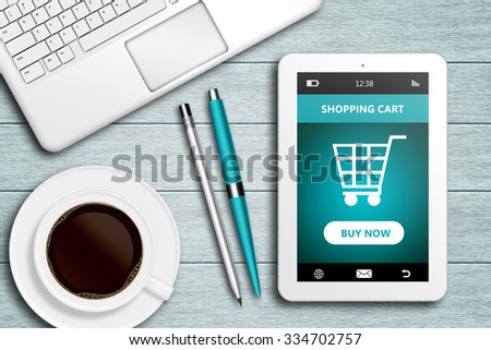 tablet with shopping cart site, computer and coffee lying on wooden desk - stock photo