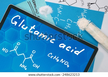 Tablet with the chemical formula of Glutamic acid  - stock photo