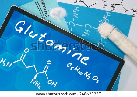 Tablet with the chemical formula of Glutamine  - stock photo