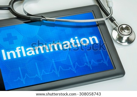 Tablet with the diagnosis Inflammation on the display - stock photo