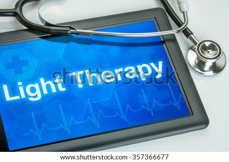 Tablet with the diagnosis Light Therapy on the display - stock photo