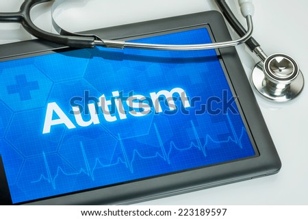 Tablet with the text Autism on the display - stock photo