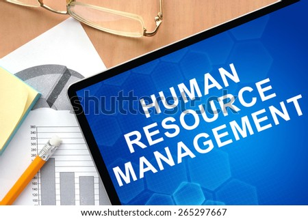 Tablet with words human resource management. Business and management concept. - stock photo