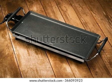 Tabletop grill on wood - stock photo