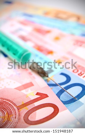 tablets and a syringe for euro banknotes. - stock photo