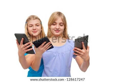 Tablets and ebook readers - Two girls playing with several tablets/ebook readers. Isolated on white. - stock photo