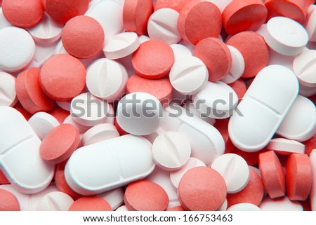tablets and white and red pills - stock photo