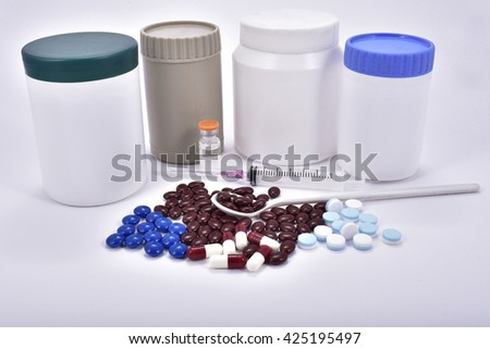 Tablets pills heap color mix therapy drugs doctor flu antibiotic pharmacy medicine medical - stock photo