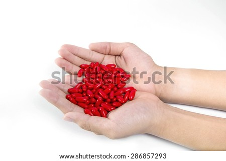 Tablets pills medicine medical on hand white background - stock photo