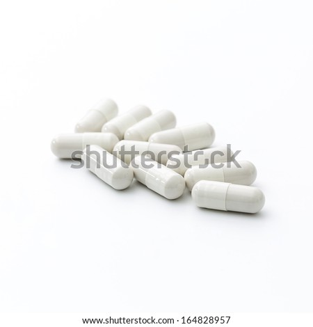 Tablets pills packaging pharmacy medicine medical on white background - stock photo