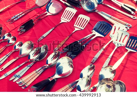 tableware and kitchenware concept - spoons and spatulas sale at street market - stock photo