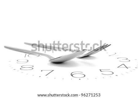 Tableware on clock face - stock photo