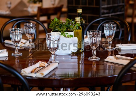 Tableware on wooden table in restaurant - stock photo