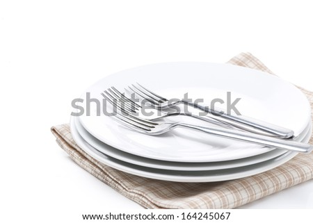 tableware - plates, forks on napkin, isolated on white - stock photo