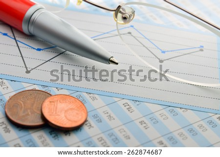 Tabulation of statistical data and business analysis in the office - stock photo