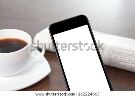 tach phone with isolated screen on a table at a businessman in office - stock photo