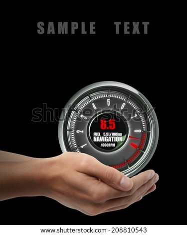 tachometer. Man hand holding object  isolated on black background. High resolution  - stock photo