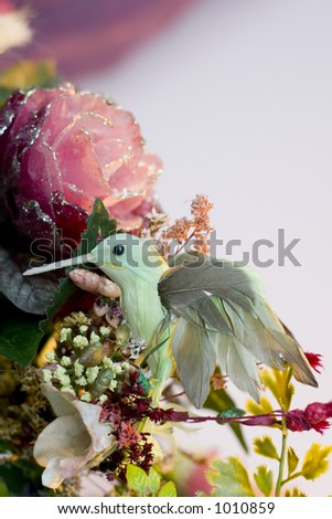 tacky hummingbird and flowers - stock photo