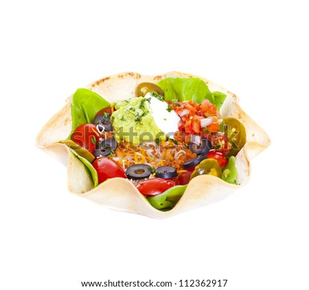Taco salad in a baked tortilla on white background - stock photo