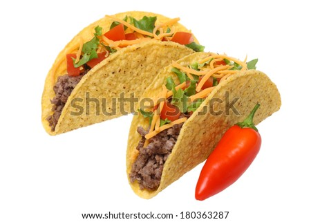 Tacos and red pepper, cutout on white background - stock photo