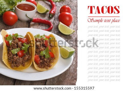 Tacos stuffed with ground beef and vegetables isolated on a wooden table - stock photo