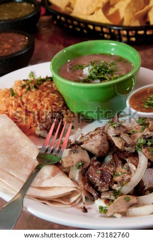 Tacos with re-fried beans and rice - stock photo