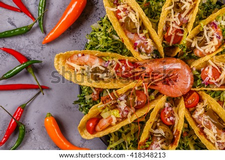 Tacos with shrimp, lettuce, cheese and jalapeno, top view. - stock photo