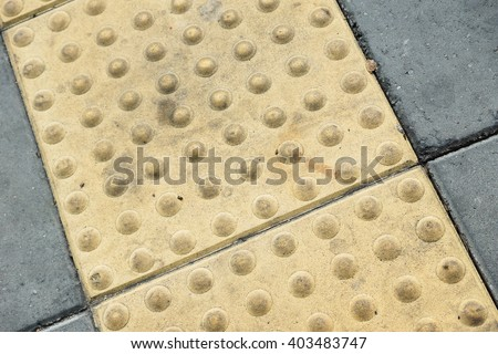 Tactile paving for blind handicap  - stock photo