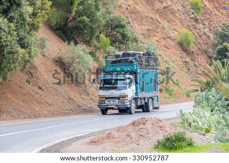 TADDERT, MOROCCO, APRIL 15, 2015: Lorry transports sheep and cows in region of Tizi n'Tichka mountain pass - stock photo