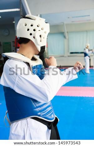 Taekwondo athlete with head gear - stock photo