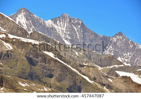 Taeschhorn (left), Dom and Lenzspitz (right) in the Mischabel Group of the southern swiss alps in the summer - stock photo
