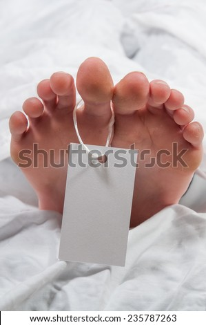 Tag on the toe of a cadaver in a morgue - stock photo